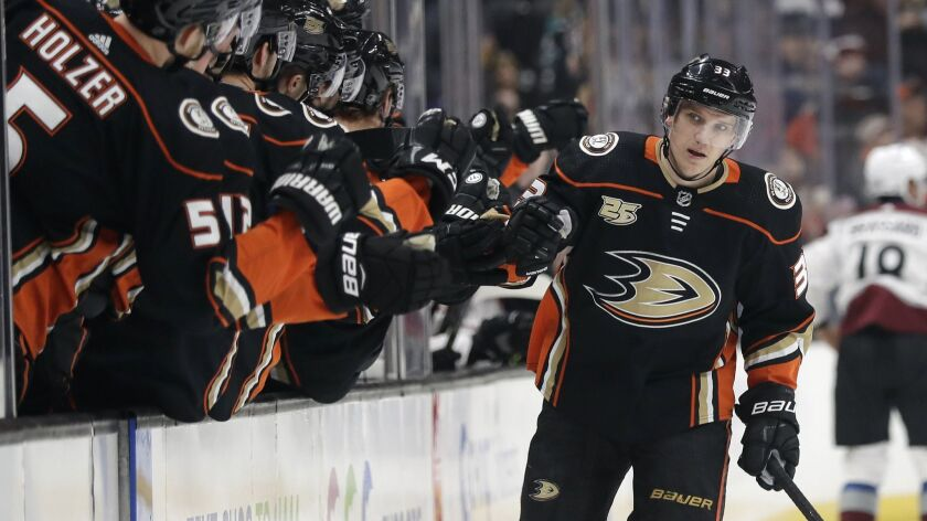 Ducks forward Jakob Silfverberg celebrates with teammates after scoring during the first period of a 2-1 victory over the Colorado Avalanche on Sunday.