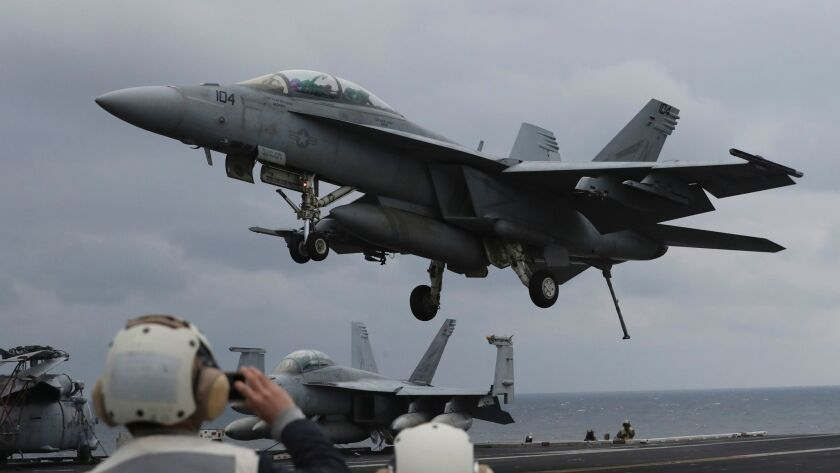 A Navy F/A-18 Super Hornet fighter approaches the deck of the U.S. aircraft carrier Carl Vinson during the annual joint military exercise called Foal Eagle between South Korea and the United States in March.