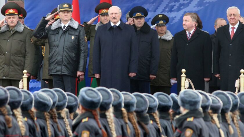 Belarusian President Alexander Lukashenko, center, attends a parade marking the 100th anniversary of the Belarusian police in Minsk.