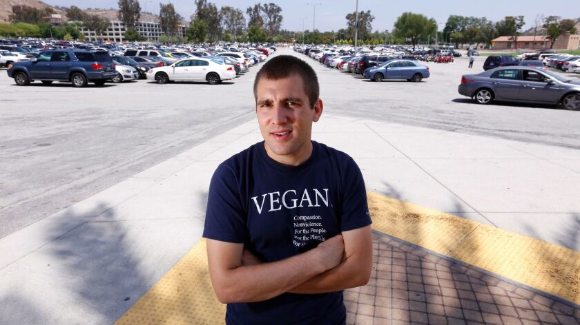 POMONA, CA. MAY 12, 2015: Nick Tomas was near the parking lot on campus at Cal Poly Pomona on May 12