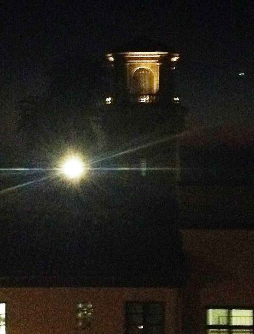 Another view of the light in question, shining over the church.
