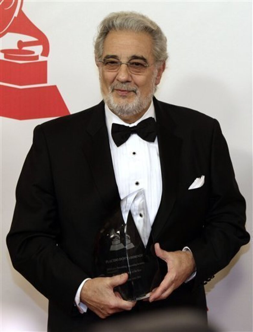 Placido Domingo arrives at the Latin Recording Academy Person of the Year event in his honor on Wednesday, Nov. 10, 2010, in Las Vegas. (AP Photo/Julie Jacobson)