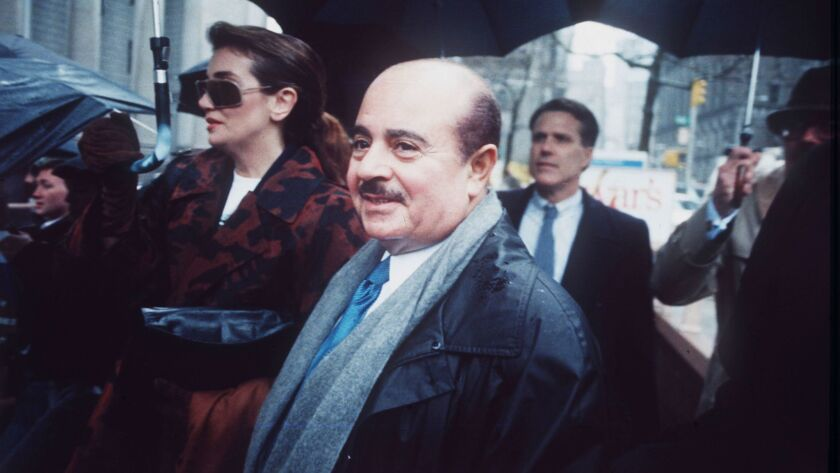 FILE - In this April 4, 1990 file photo, Adnan Khashoggi arrives at Manhatten Federal Court, New Yor