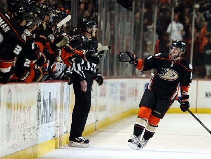 Anaheim Ducks right wing Kyle Palmieri, right, is congratulated after scoring a goal against the Los Angeles Kings in the first period of an NHL hockey game in Anaheim, Calif., Sunday, April 7, 2013. (AP Photo/Christine Cotter)