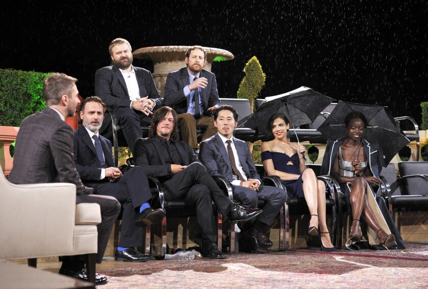 """Host Chris Hardwick (bottom row from left), actors Andrew Lincoln, Norman Reedus, Steven Yeun, Lauren Cohan, Danai Gurira and (top row from left) creator Robert Kirkman and showrunner Scott Gimple at the Hollywood Forever Cemetery on Sunday for """"Talking Dead Live."""""""