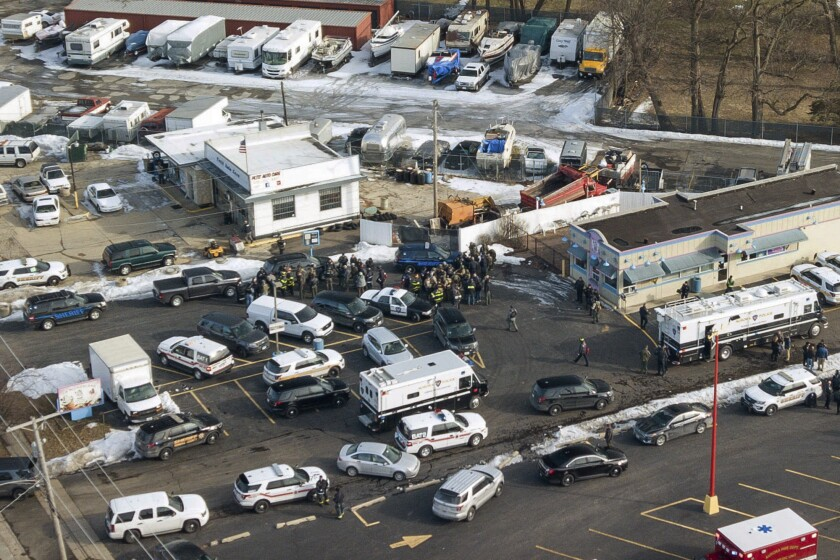 Police surround a manufacturing plant in Aurora, Ill., where a gunman killed five people and wounded five police officers.