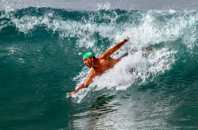 Adam Leste competes in the 35-44 age group of the World Body Surfing Championships Saturday at the Oceanside Municipal Pier. Photo by Bill Wechter.
