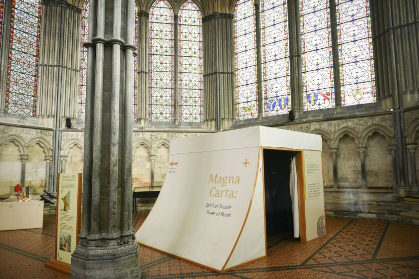 The small viewing cubicle which houses the glass case storing the Magna Carta, inside the Chapter House at Salisbury Cathedral.