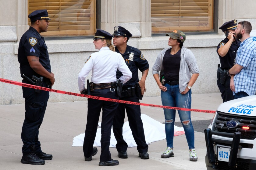 Police investigate the scene where a pedestrian was fatally struck by a car on E. 79th Street and Madison Avenue in Manhattan on Friday.