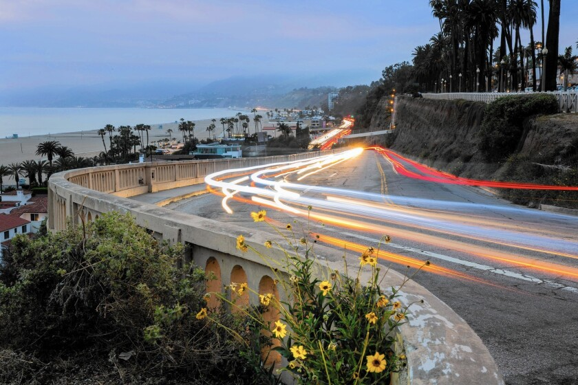Light trails are captured with a long camera exposure as cars move up and down the California Incline in Santa Monica.