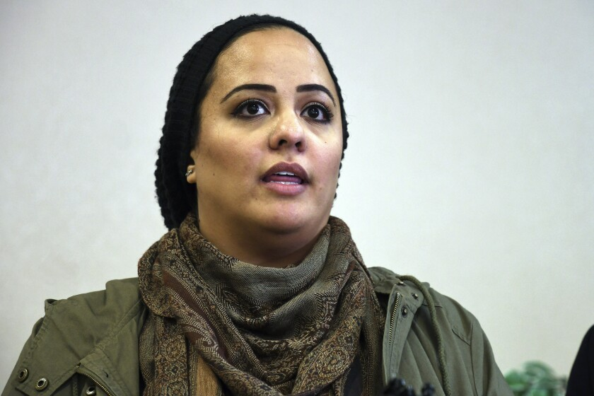 """Gazella Bensreiti speaks during a news conference in Denver, Wednesday, Nov. 13, 2019. The Westminster woman says an arena security guard told her to remove her hijab before she could enter to see her 8-year-old daughter sing the national anthem with her school choir at a Denver Nuggets basketball game on Nov. 5. Kroenke Sports & Entertainment, which owns the Pepsi Center, called the encounter a """"misunderstanding"""" and said the guard didn't recognize that Bensreiti was wearing a hijab. (AP Photo/Thomas Peipert)"""