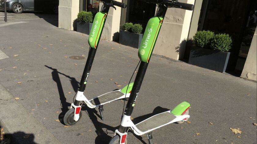 Scooter for sharing park in Paris, Tuesday, July 3, 2018. California-based bicycle sharing service L