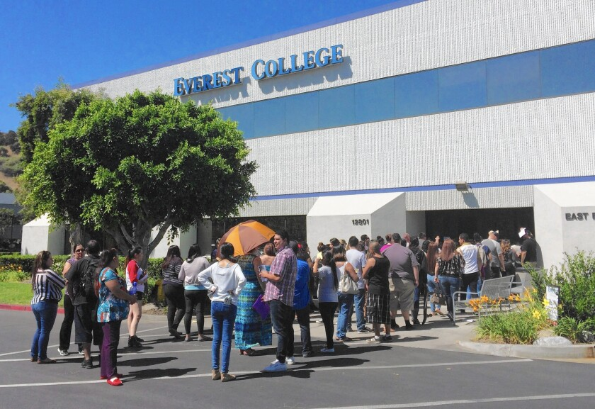 Students wait outside Everest College in City of Industry last week, hoping to get their transcripts and information on loan forgiveness and on transferring credits to other schools. The campus is among those abruptly shut down by Corinthian Colleges.