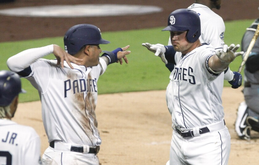 The Padres' Hunter Renfroe, right, celebrates with Manny Machado after the first of Renfroe's two home runs on Tuesday.