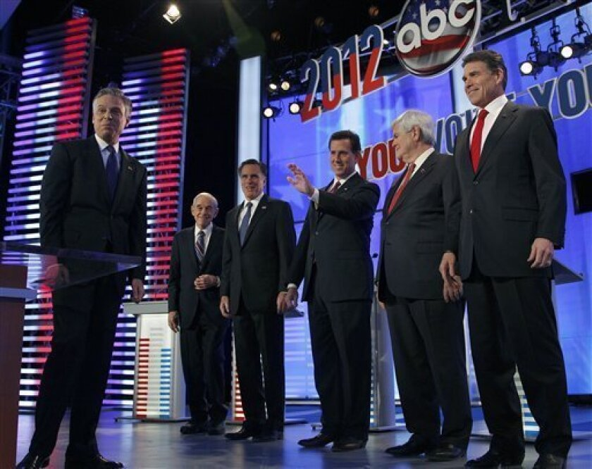 Former Utah Gov. Jon Huntsman, Rep. Ron Paul, R-Texas, former Massachusetts Gov. Mitt Romney, former Pennsylvania Sen. Rick Santorum, former House Speaker Newt Gingrich and Texas Gov. Rick Perry (L-R) are introduced before a Republican presidential candidate debate at Saint Anselm College in Manchester, N.H., Saturday, Jan. 7, 2012. (AP Photo/Elise Amendola)