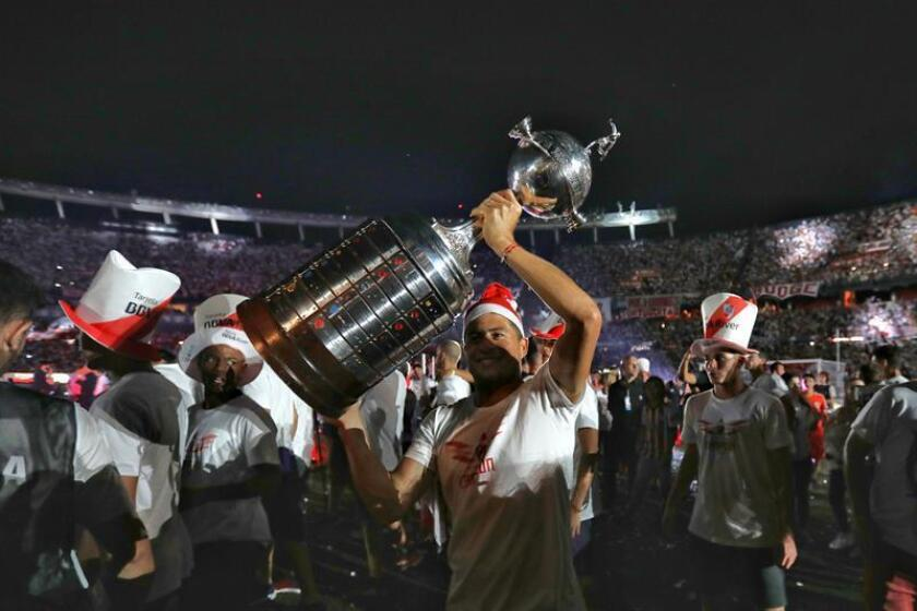 River Plate's Jorge Moreira hoists the Copa Libertadores trophy during a celebration with fans on Dec. 23, 2018, at Monumental Stadium in Buenos Aires, Argentina. EPA-EFE FILE/Juan Ignacio Roncoroni