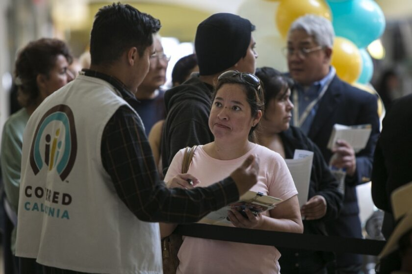 Open enrollment for health coverage under the Affordable Care Act runs Nov. 1 to Jan. 31. Above, people wait to sign up at a Covered California event in Panorama City last year.