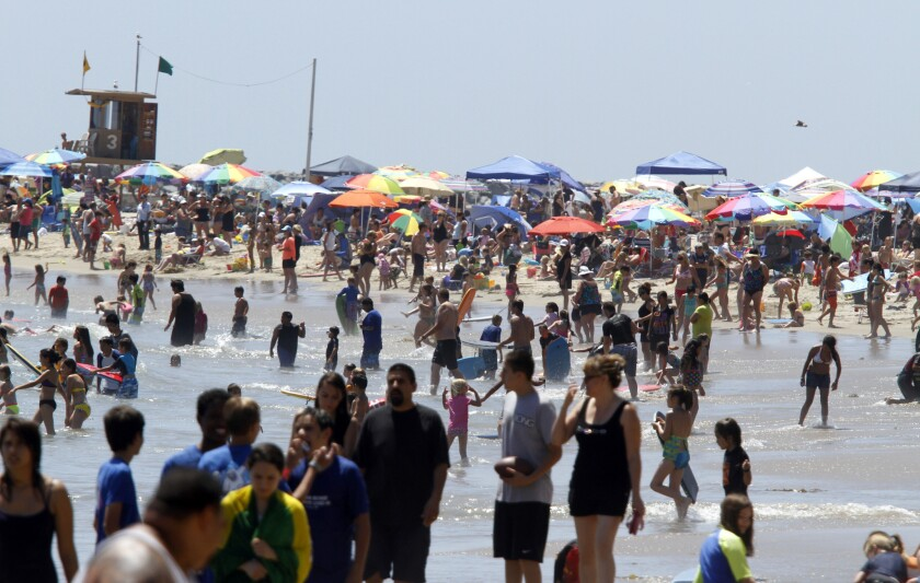 Approximately 1.6 million people visit Corona del Mar State Beach every year. Newport Beach is looking into outsourcing lifeguard services for the stretch of coastline, seen here in June 2012.