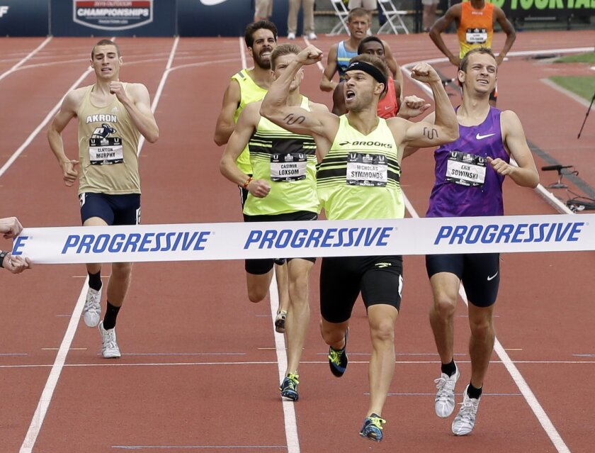 FILE - In this June 28, 2015, file photo, Nick Symmonds wins the 800 meter event at the U.S. Track and Field Championships in Eugene, Ore. Symmonds is boycotting world championships that begin Saturday, Aug. 22, 2015, in protest of what he said is an unfair contract that forced him to wear Nike gear at all team functions. (AP Photo/Don Ryan, File)