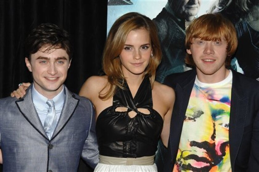 """From left, actors Daniel Radcliffe, Emma Watson and Rupert Grint attend the premiere of """"Harry Potter and the Half Blood Prince"""", in New York, on Thursday, July 9, 2009. (AP Photo/Peter Kramer)"""