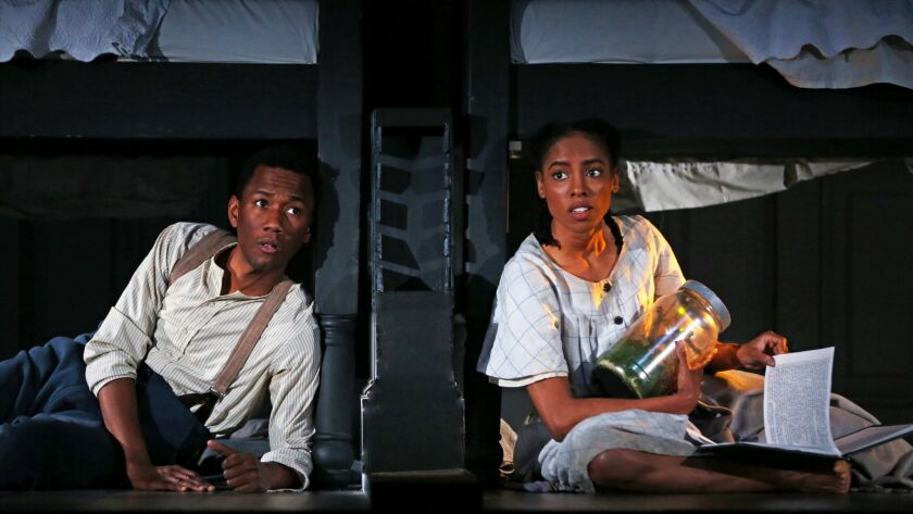 "Giovanni Adams is Colis, left, and Chauntae Pink is Toy in Kemp Powers' ""Little Black Shadows"" at South Coast Repertory."