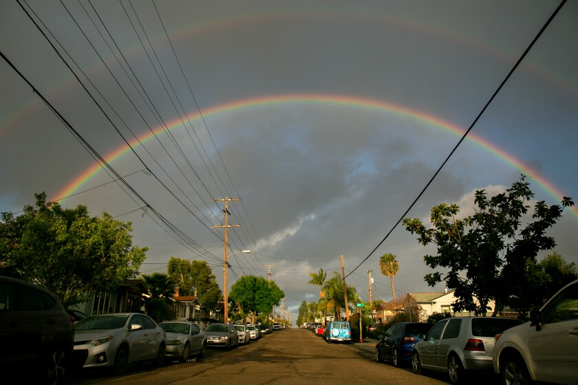 A rainbow peeks through the clouds in Normal Heights on March 26, 2020 in San Diego, California. San Diego air quality has been improving in recent years, but ozone levels are still high.
