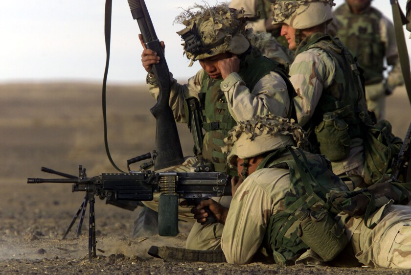 Marines stationed at Camp Rhino in Afghanistan perform a weapons test.