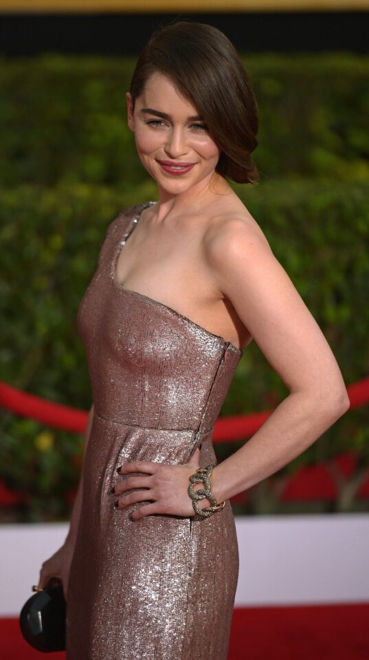"""The """"Game of Thrones"""" actress wore a dramatic liquid metallic Calvin Klein dress with a single cap sleeve. It was a modern goddess gown and it made her look like a beautiful bronze statue."""