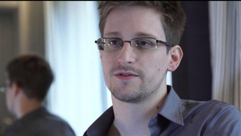 This photo provided by The Guardian Newspaper in London shows Edward Snowden, who worked as a contract employee at the National Security Agency, on Sunday, June 9, 2013, in Hong Kong. The National Security Agency, working with the British government, has secretly been unraveling encryption technology that billions of Internet users rely upon to keep their electronic messages and confidential data safe from prying eyes, according to published reports Thursday, Sept. 5, 2013, based on internal U.S