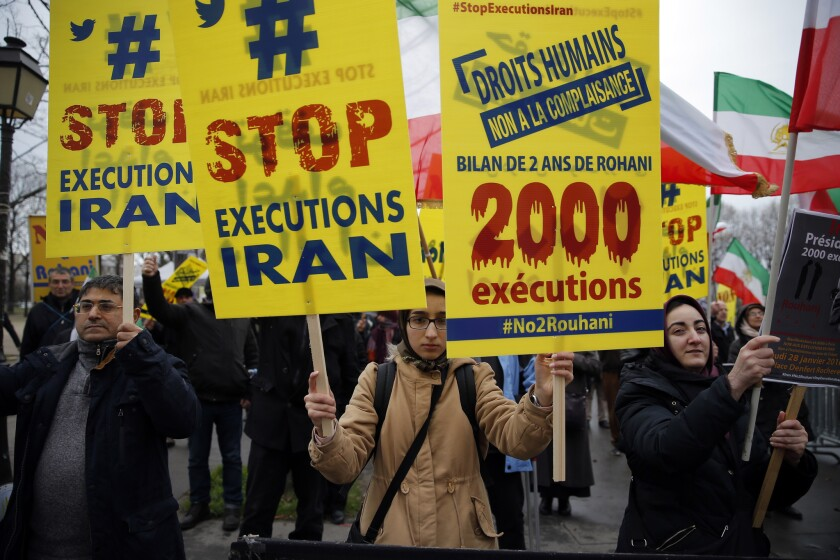 Demonstrators protest Iranian President Hassan Rouhani's visit to Paris in January 2016. Iran executed at least 966 prisoners in 2015, the highest number in over two decades, according to Ahmed Shaheen, the United Nations special rapporteur on human rights in Iran.