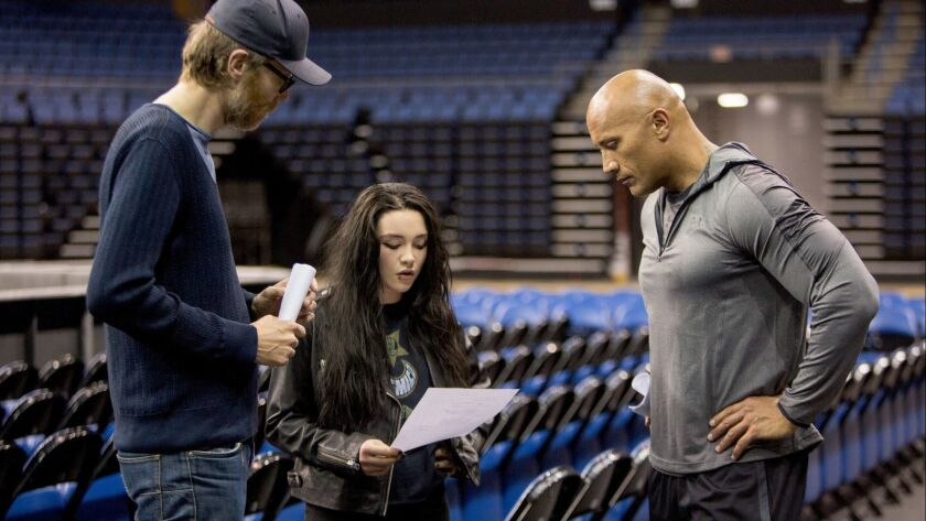 (From L to R) Director Stephen Merchant, actor Florence Pugh and actor Dwayne Johnson on the set of