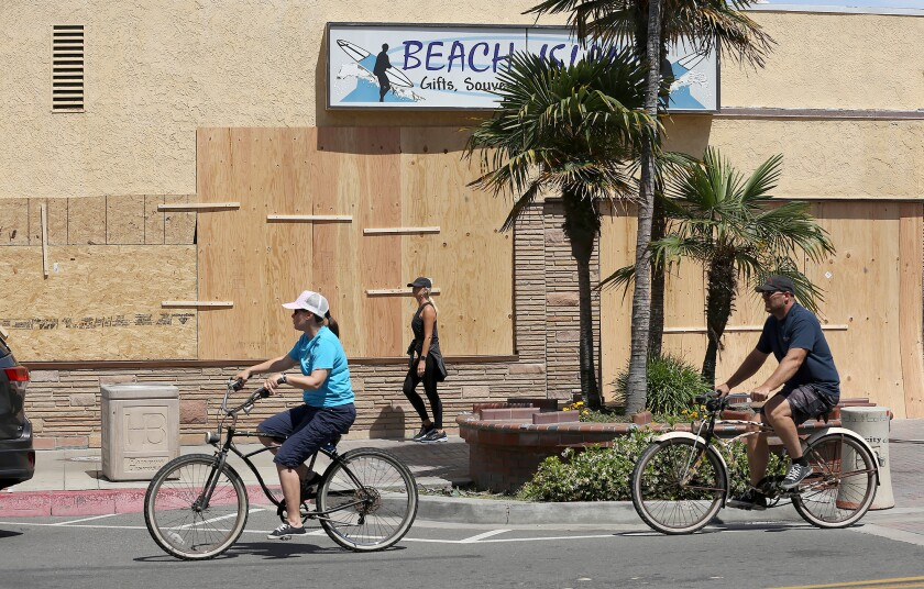 Plywood panels protected several storefronts during Sunday's protest in downtown Huntington Beach.