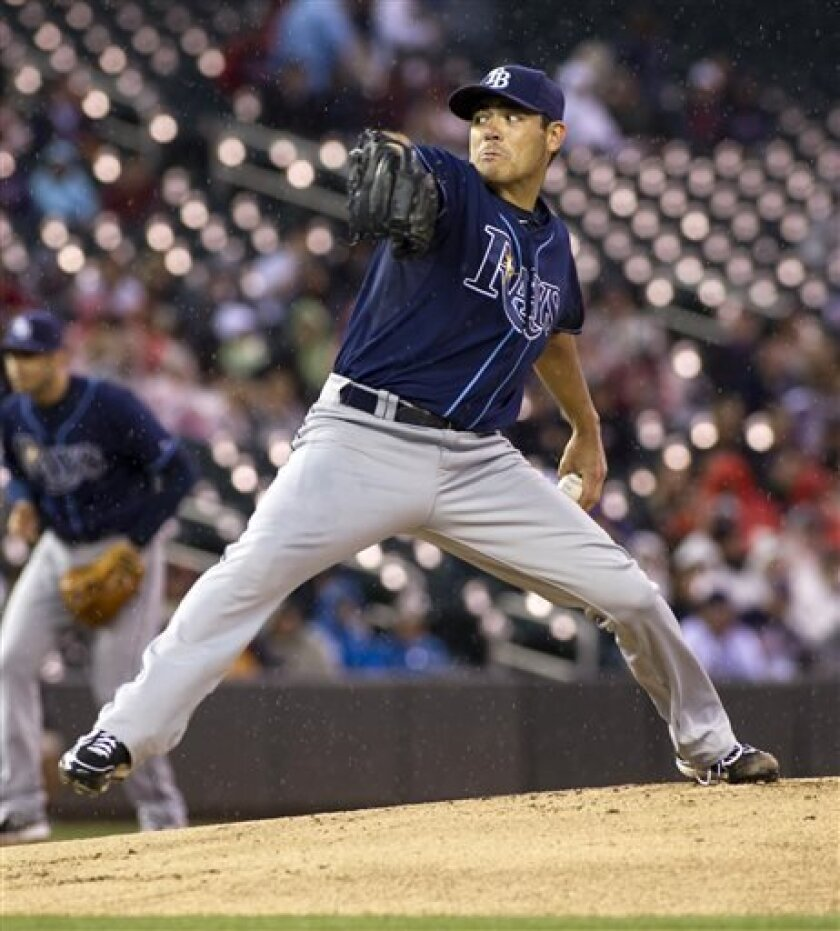 Tampa Bay Rays starting pitcher Matt Moore delivers during the first inning of a baseball game against the Minnesota Twins, Saturday, Sept. 14, 2013, in Minneapolis. (AP Photo/Paul Battaglia)