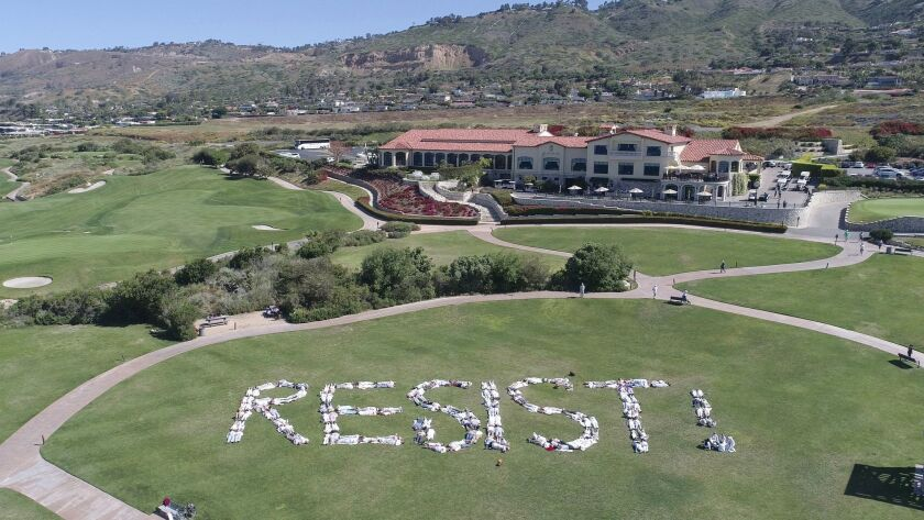 Protesters spelled out 'RESIST!' at President Trump's golf course in Rancho Palos Verdes on Saturday.