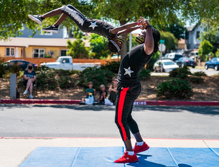 An acrobatic duo with Fern Street Circus performs at Rosa Parks Elementary School