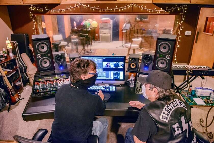 Alan Sanderson (left) and Electric Mud promoter Chris Faust put the finishing touches on the band's new album.