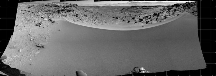 This view from NASA's Mars rover Curiosity shows the terrain to the west from the rover's position on the 528th Martian day of the mission (Jan. 30, 2014). The team is considering whether to make the drop down the dune pictured, known as Dingo Gap.