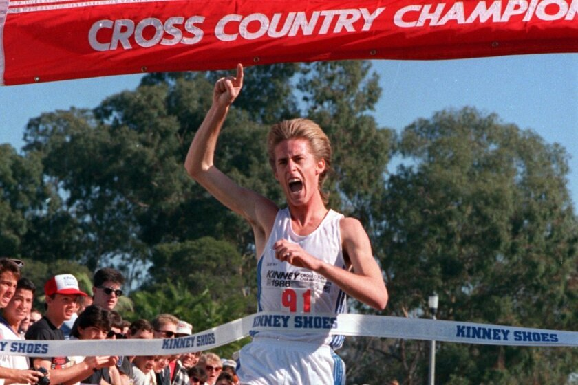 Marc Davis of San Diego High savors his national cross country title in 1986 at Morley Field.
