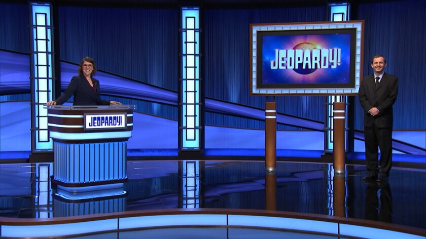 """John Klass of Huntington Beach, right, is shown on the set of """"Jeopardy!"""" with host Mayim Bialik."""