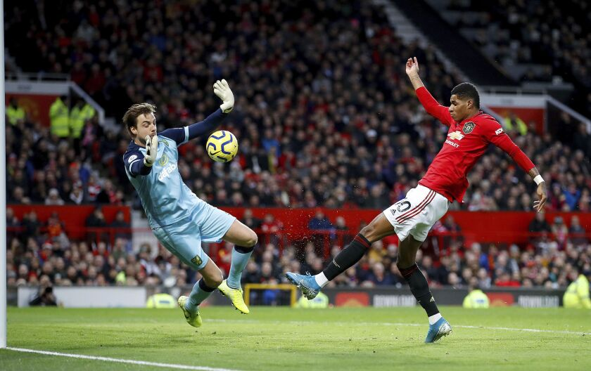 Manchester United's Marcus Rashford scores during the English Premier League soccer match between Manchester United and Norwich City at Old Trafford, Manchester, England, Saturday Jan. 11, 2020. (Martin Rickett/PA via AP)