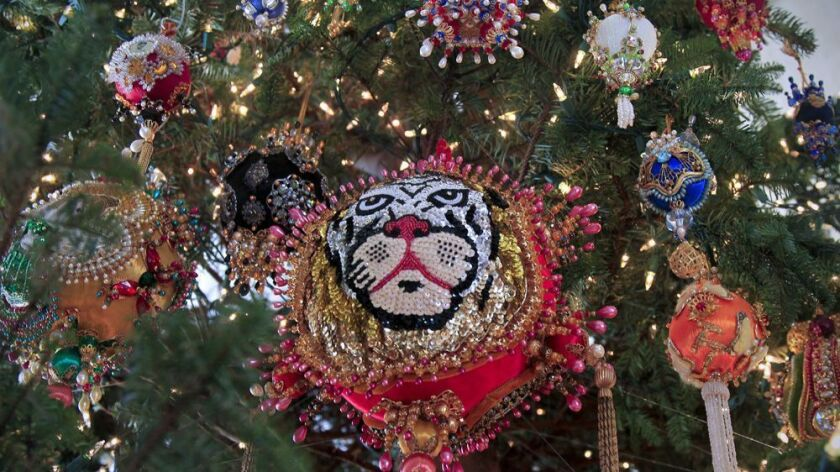 Christmas tree ornaments from Elizabeth Schlappi's rare handmade collection. Dozens of ornaments are displayed on the Christmas tree at the Timken Museum of Art in Balboa Park.
