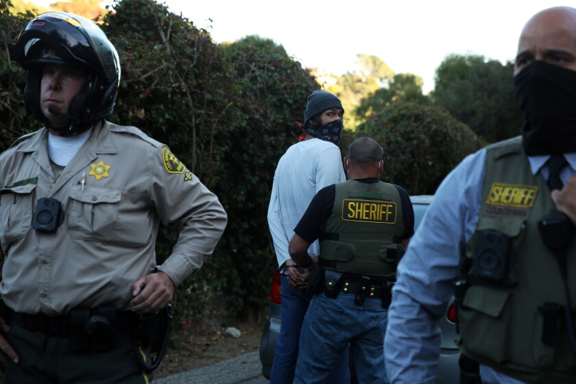Emanuel Padilla is arrested after a protest outside Sheriff Villanueva's home in La Habra Heights Nov. 18.