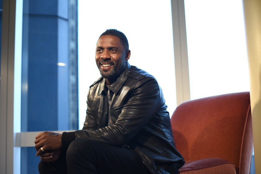 3017566_la-ca-mn-idris-elba-mountain-between-us