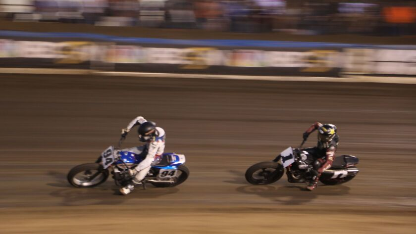 Ryan Wells leads Bryan Smith during the Cycle Gear American Flat Track Finals at Perris Auto Speedway.