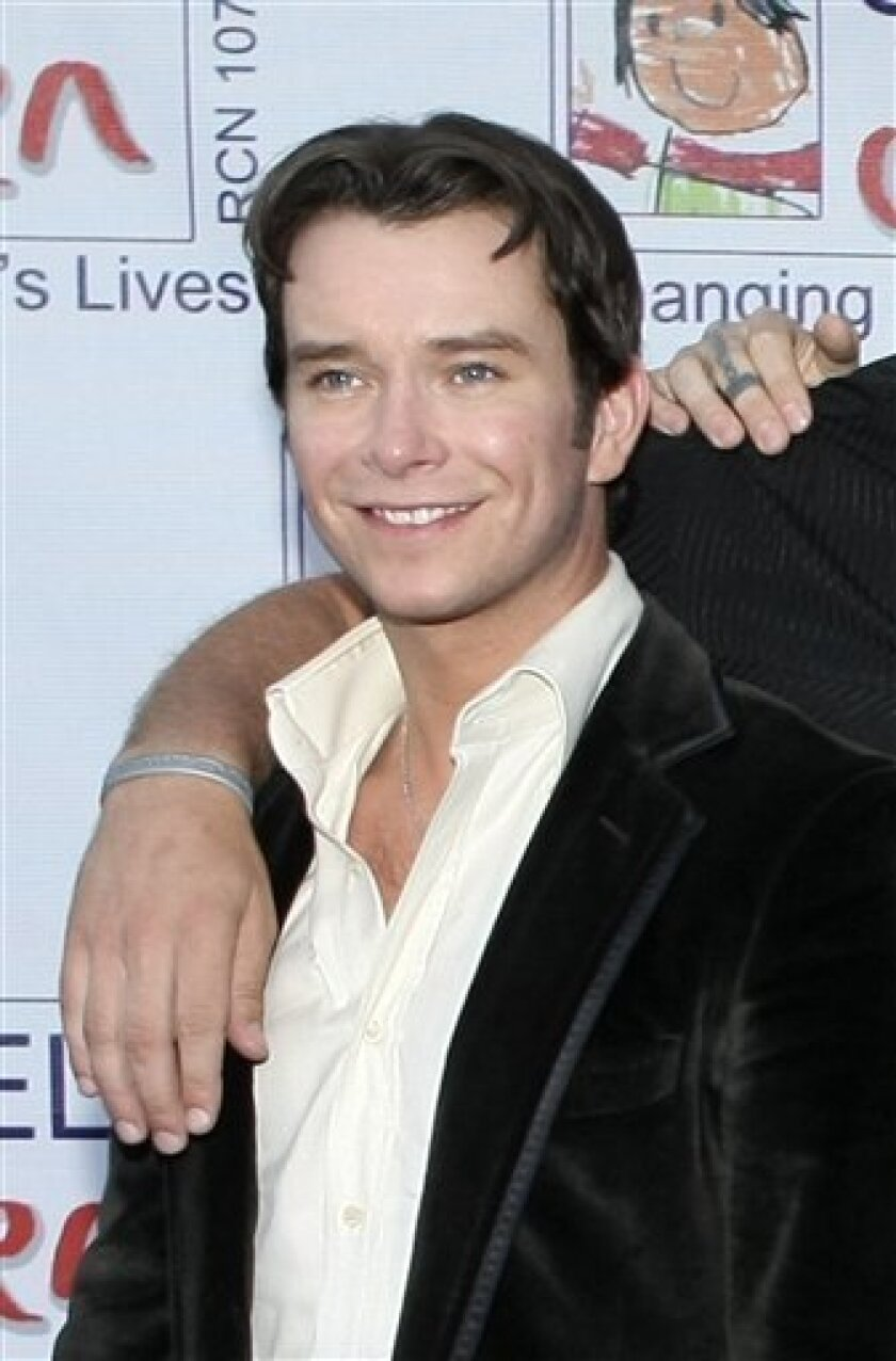 FILE - In this May 8, 2008 file photo, Stephen Gately poses for photographs with other members of Irish band Boyzone, not pictured, as they arrive at the Caudwell Children's Charity Legends Ball in London, Britain. Singer Gately has died while on vacation in Spain, the group said on its Web site Sunday Oct. 11, 2009. He was 33. (AP Photo/Matt Dunham, File)