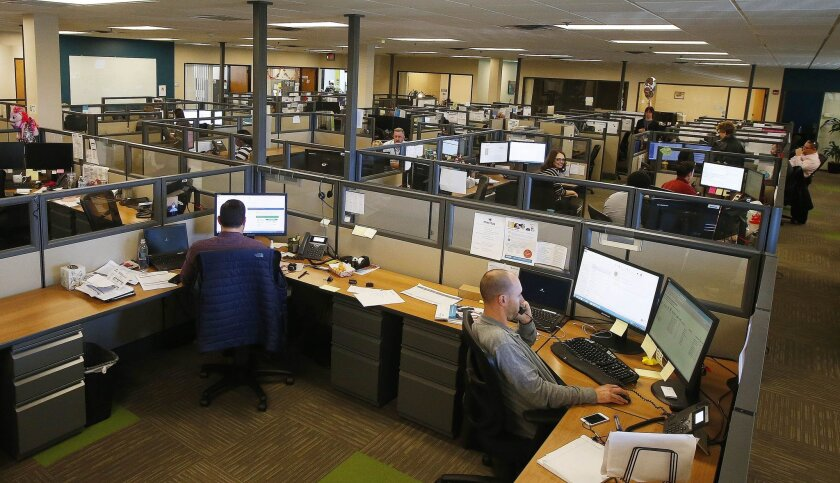In this photo taken Thursday, Nov. 19, 2015, staffers at Meritus Health Partners work at their office space at headquarters Thursday, Nov. 19, 2015, in Tempe, Ariz. Executives with Arizona's nonprofit health insurance co-op said Tuesday, Nov. 24, 2016, that they have failed to come up with additional financial backing and the insurer plans to shut down all operations Dec. 31. (AP Photo/Ross D. Franklin)