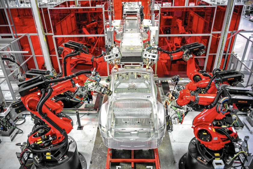 Robots assemble Model S sedans at Tesla's 5.3-million-square-foot plant in Fremont, Calif.