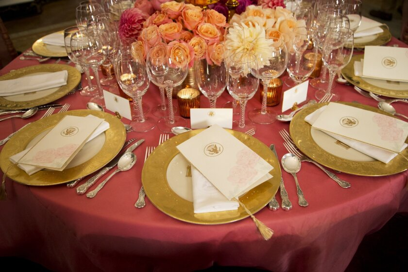 A table setting is shown during a preview in the State Dining Room of White House in Washington, Thursday, Sept. 24, 2015, for the state dinner of the visiting Chinese President Xi Jinping. It will be Colorado lamb on the menu and Grammy-winning R&B singer Ne-Yo as the entertainment, when President