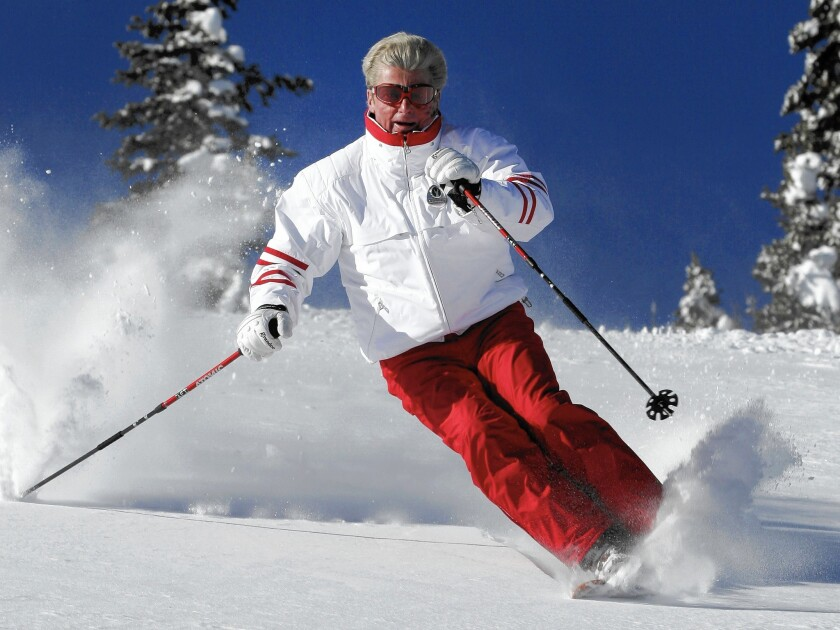 Stein Eriksen skiing at Deer Valley Resort in Park City, Utah, in 2005. He captured gold in giant slalom and silver in slalom in the 1952 Winter Games in Oslo. Later, he held positions at various ski resorts in the United States.