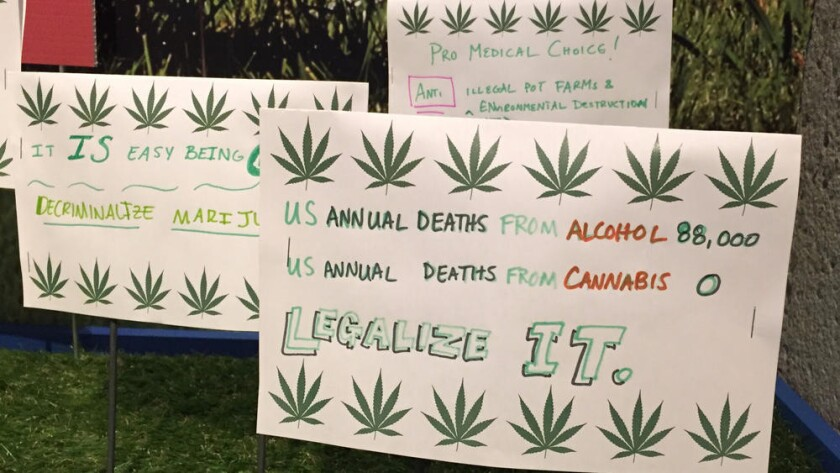 Signs created by visitors to the Oakland Museum's marijuana exhibit in June 2016.